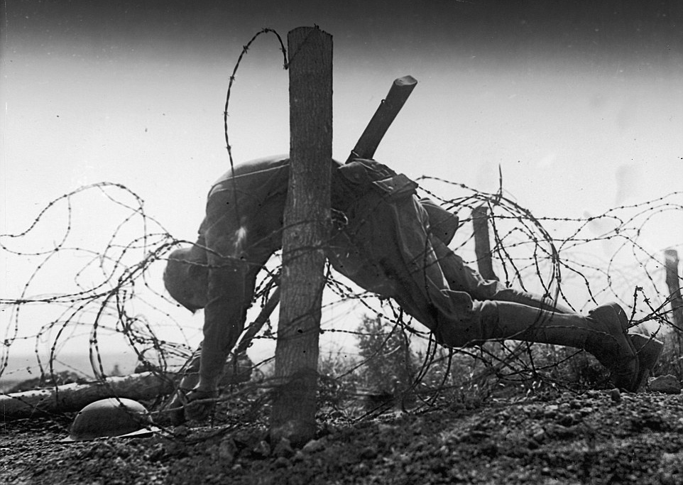 U.S. soldier in barbed wire