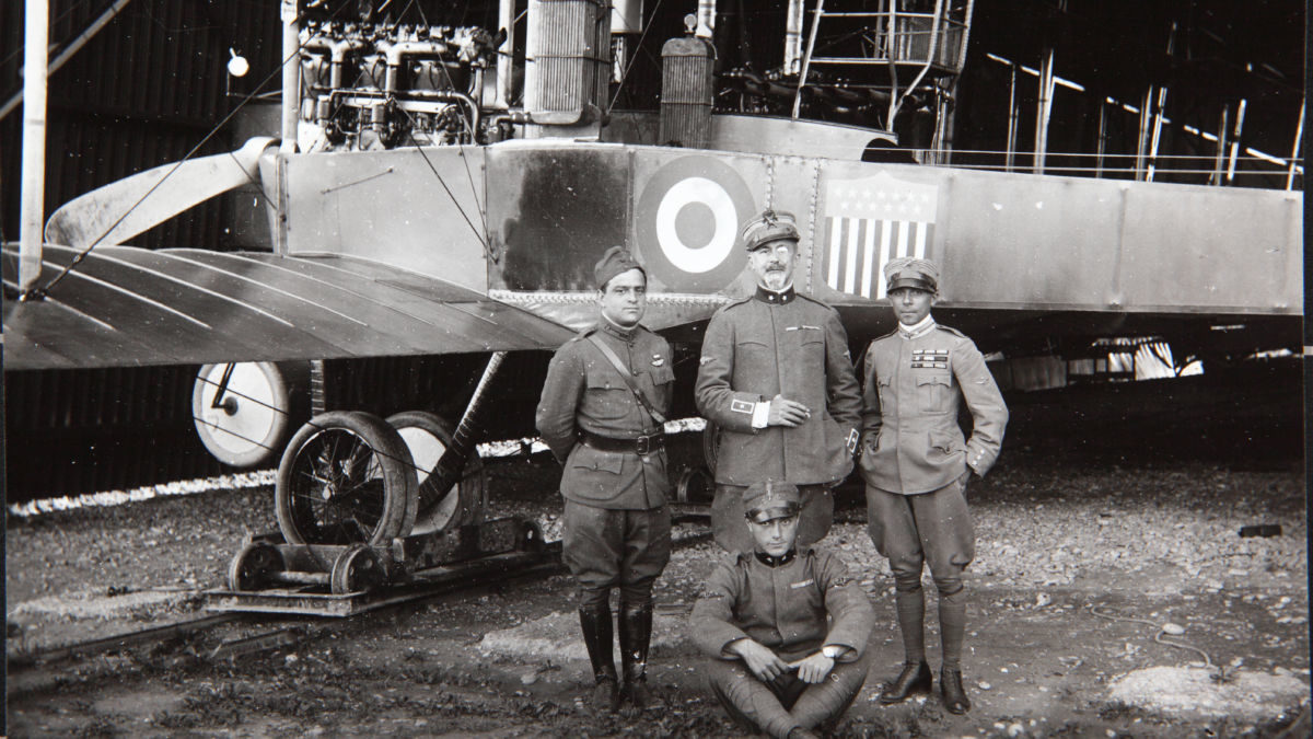 "Fiorello La Guardia stands with Italian air force colleagues Major Piero Negrotto, Captain Federico Zapelloni and Sergeant Firmani in front of their Caproni bomber, the ""Congressional Limited.""  (San Diego Air & Space Museum)"